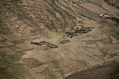 Aerial view of Quechua settlement and fields in Andes, Bolivia, South America