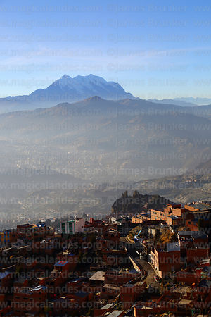 Dusty haze in valleys in lower part of city, Mt Illimani in background, La Paz, Bolivia