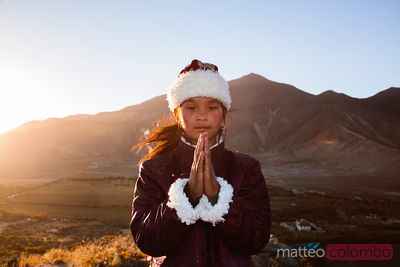 Portrait of young girl praying, Tibet