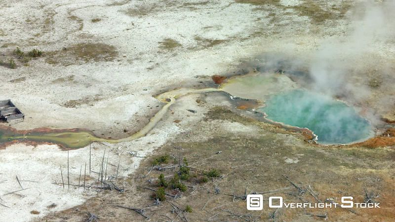 A colorful thermal pool gives off steam in the cool atumn air in Yellowstone National Park