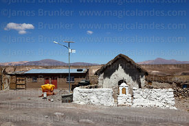 Solar panel next to rustic church at Ancuta, Las Vicuñas National Reserve, Region XV, Chile