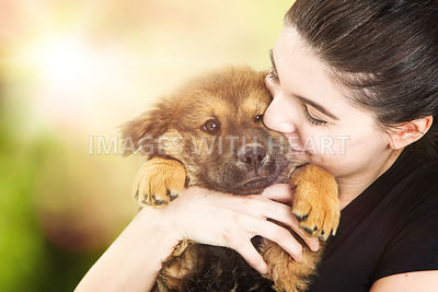 Beautiful Young Woman Holding Cute Puppy Outdoors
