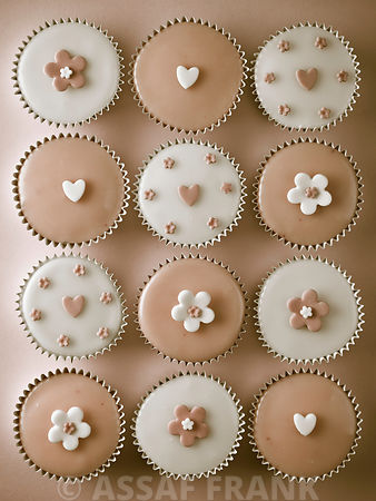 Cupcakes with flower and heart shape decorations
