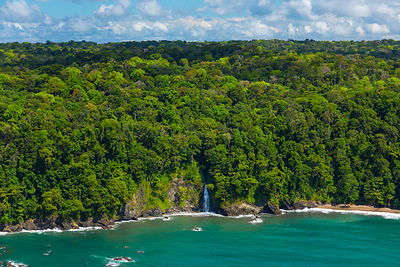Aerial view of waterfall on the coastline of Corcovado National Park, Osa Peninsula, Puntarenas Province, Costa Rica. Decembe...