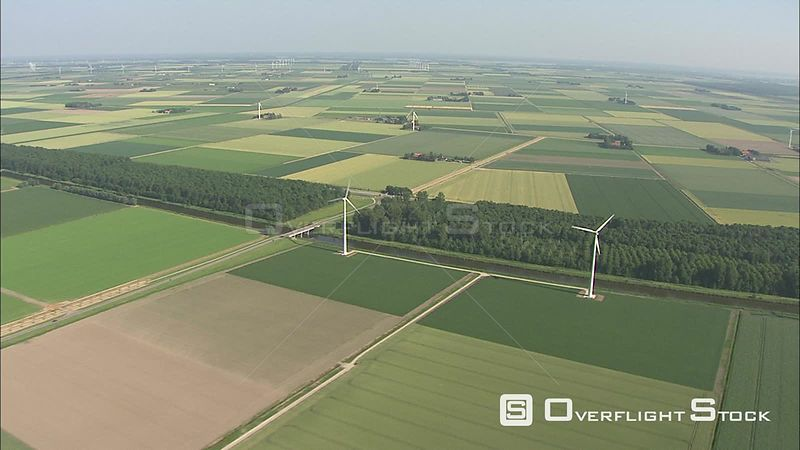 Green fields dotted with windmills in Flevoland, The Netherlands
