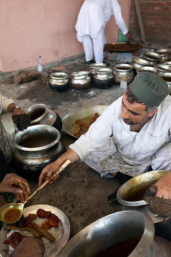 India - Srinagar - Mohammed Ayub, 43 a Waza or traditional cook in teh Kashmiri tradition cooks and serves food at Wazwan feast