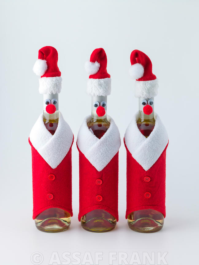 Christmas wine bottle on white background