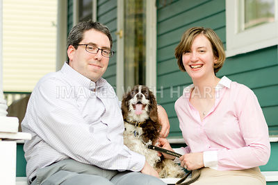Dog with man and woman on porch steps