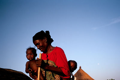 Asumpaheme carries her grandchild and a neighbours child