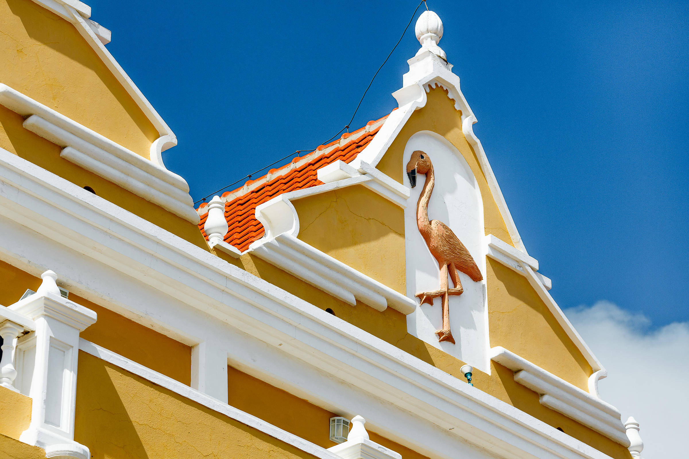 Colourful building with flamingo sculpted on the front Kralendijk, Bonaire