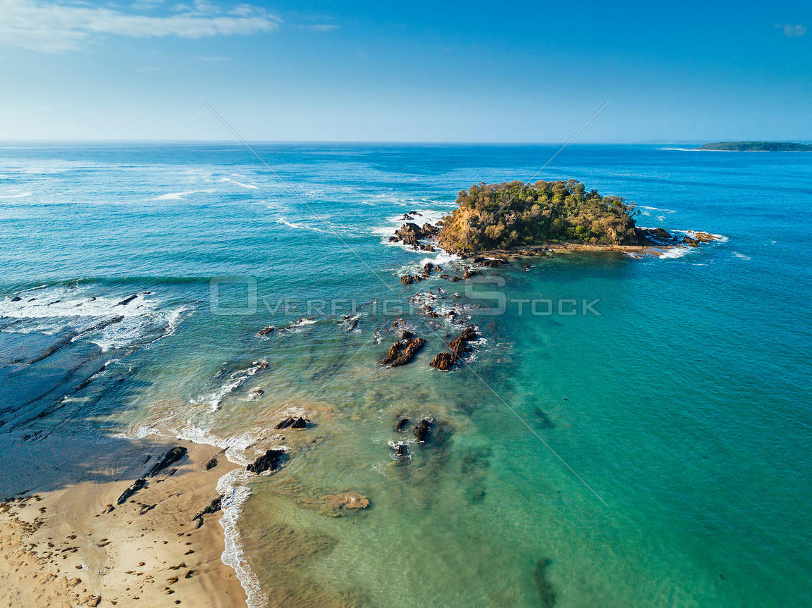 One of the many small islands in the Batemans Bay area surrounded by beautiful blue green waters. NSW Australia
