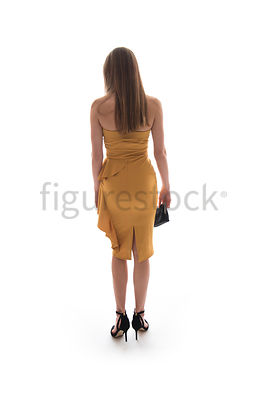 A mystery woman wearing a party dress, from behind – shot from eye level.