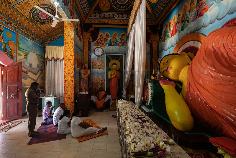 People Pray at the Reclining Buddha at Jethawanaramaya Stupa.