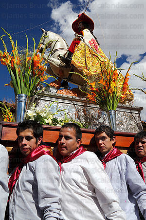 Bearers carrying figure of San Santiago / St James the Moor Slayer during Corpus Christi festival , Cusco , Peru