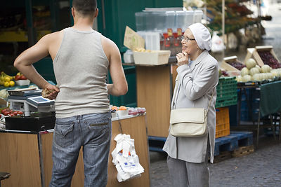 France - Paris - A stall holder talks to an elderly lady on the Rue Mouffetard.