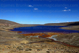 Stream contaminated by mining waste entering Laguna Milluni, La Paz Department, Bolivia