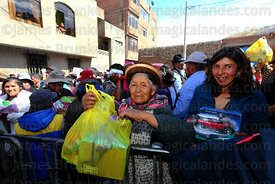 People wait outside church for priest to bless their miniatures after mass at Alasitas festival, Puno, Peru
