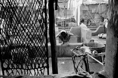 India - Mumbai - A Dhobi (or washerman) in Bombay (now Mumbai) washes after his days' work