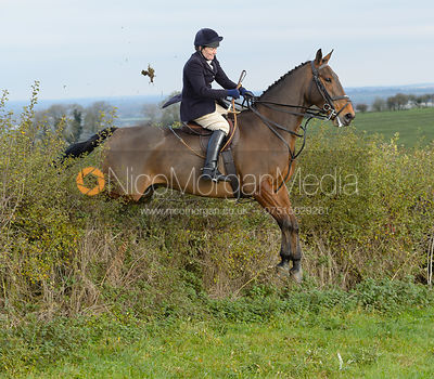 Sophie Oliver jumping a hedge near Clawson Thorns