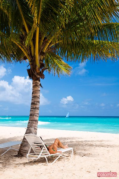 Woman relaxing on the beach in the Caribbean