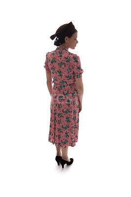 A semi-silhouette of a 1940's woman in a flowery dress and hat – shot from eye-level.