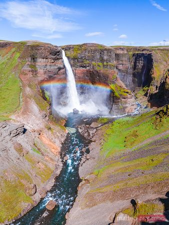 Aerial drone view of Haifoss waterfall with rainbow, Iceland