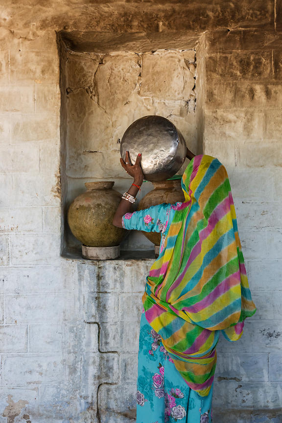 Marwari Woman Filling her Home Refrigeration Pots with Well Water