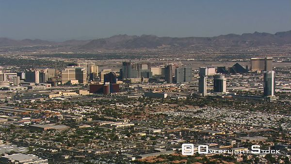 Wide flight past Las Vegas high-rise hotels and casinos.