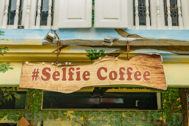 "SINGAPORE CITY, SINGAPORE - OCTOBER 08, 2016:  A""Selfie Coffee"" sign above a cafe in Haji Lane, Singapore.  The street is a p..."