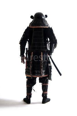 A semi-silouette of a Samurai warrior facing away - shot from eye-level.
