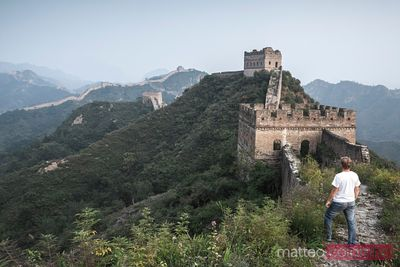 Tourist looking at the Great Wall of Jinshanling, China