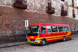 Public bus at bus stop in front of Inca stone wall, Plaza San Pedro , Cusco , Peru