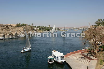 Tourist boats and feluccas (traditional sailing vessels) on the River Nile at Aswan, Egypt