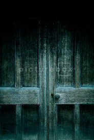An atmospheric image of a spooky old door.