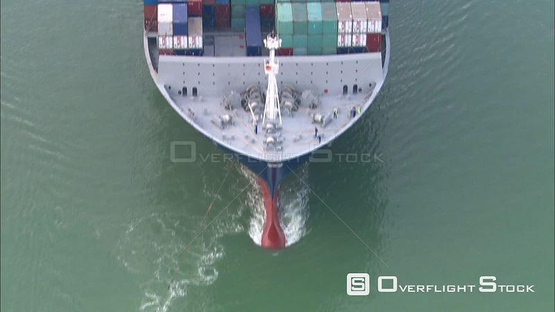 Orbiting a freighter and attendant tugs leaving harbor at Zeebrugge, Belgium