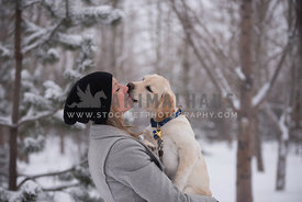 Puppy kissing owner