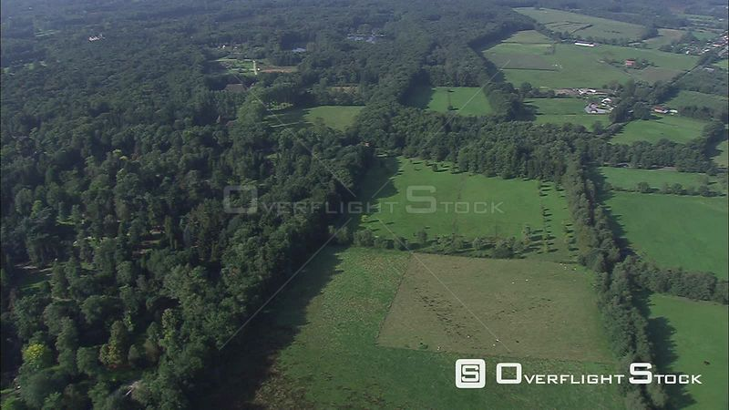 Above forest and traditional Flemish farmsteads in the Provincial Domain of Bokrijk, Belgium