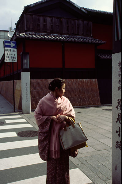 A woman in traditional dress in the Gion district