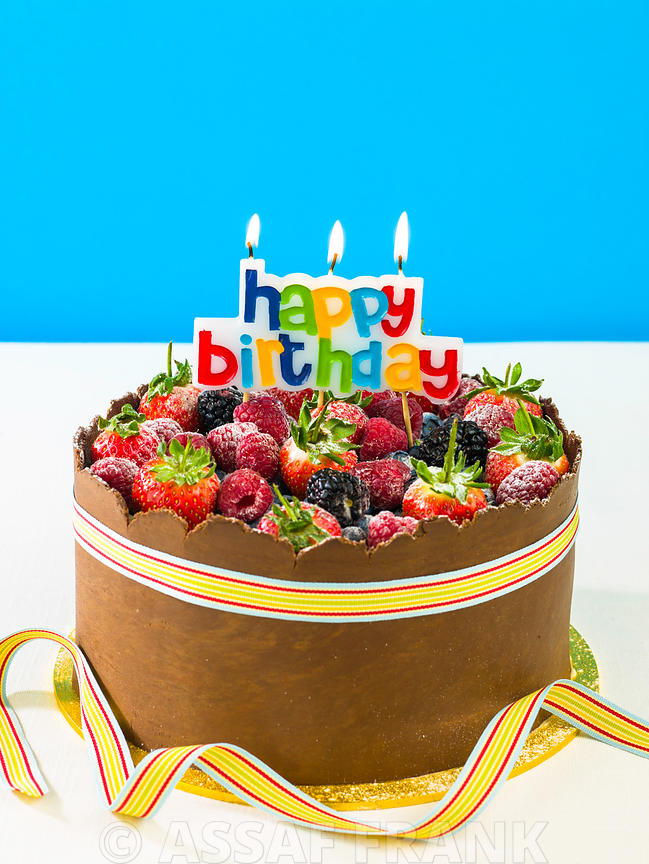 Mix fruit birthday cake with candles
