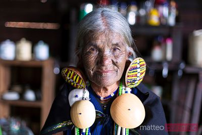 Old burmese woman with traditional facial tattoo