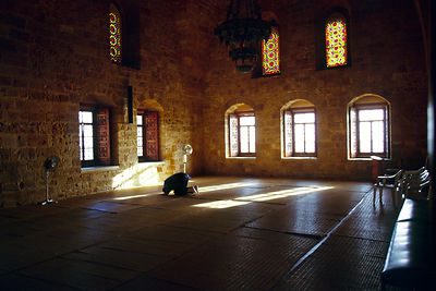Lebanon - Tyre - A man prays alone at the Imam Khomayni mosque