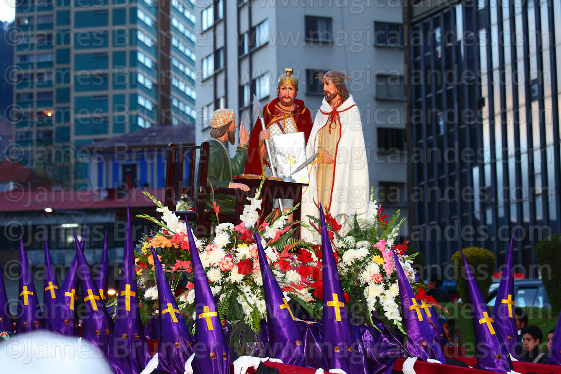 Penitents carrying statue of Señor de la Sentencia / Lord of Judgment during Good Friday procession, La Paz, Bolivia