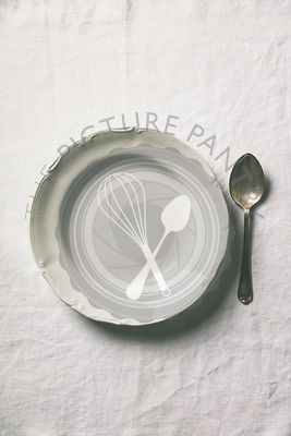 Empty soup plate and spoon