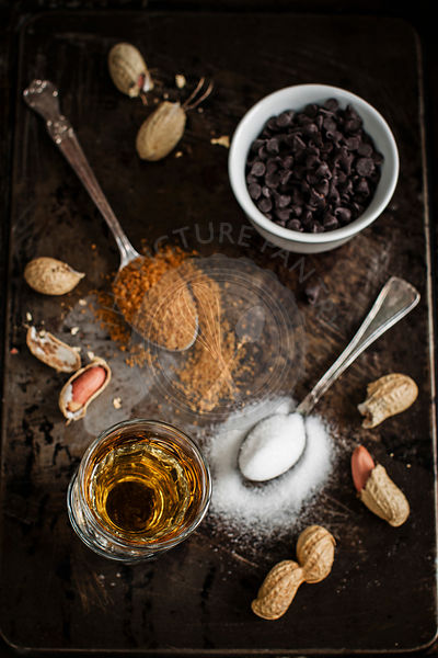 Work in progress for bourbon and peanut mini cakes: ingredients ready on a vintage pan