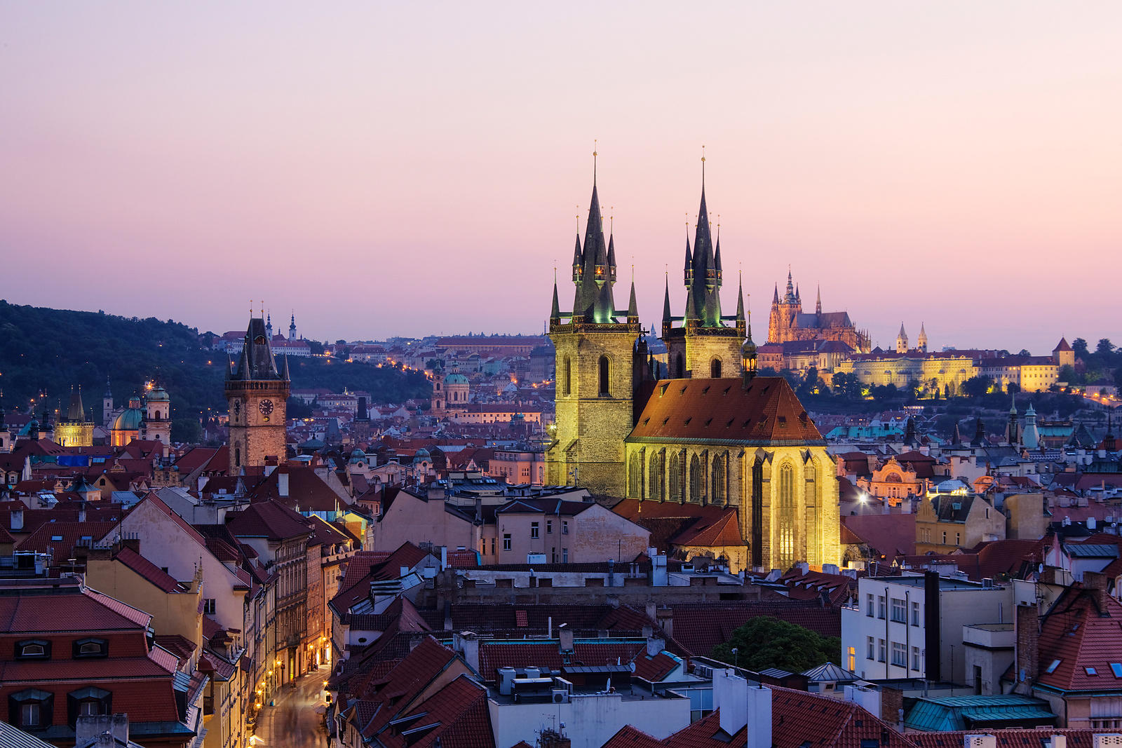 Prague Skyline at Dusk. View of the Church of Our Lady Before Tyn and Prague Castle