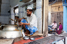 India - Delhi - A man serving Nihari (a meat stew) at the Haji-Shabrati Nihari wallah