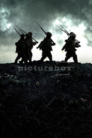 An atmospheric image of silhouetted British soldiers on the front line in WW1.