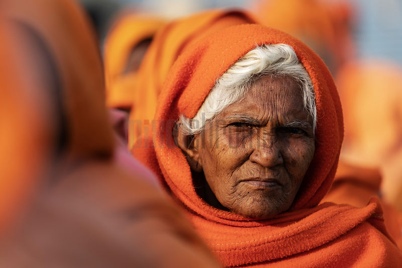 A Sadhvi (Female Sadhu) Stands in Line at a Food Kitchen