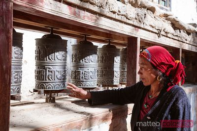Local woman spinning prayer wheels, Nepal