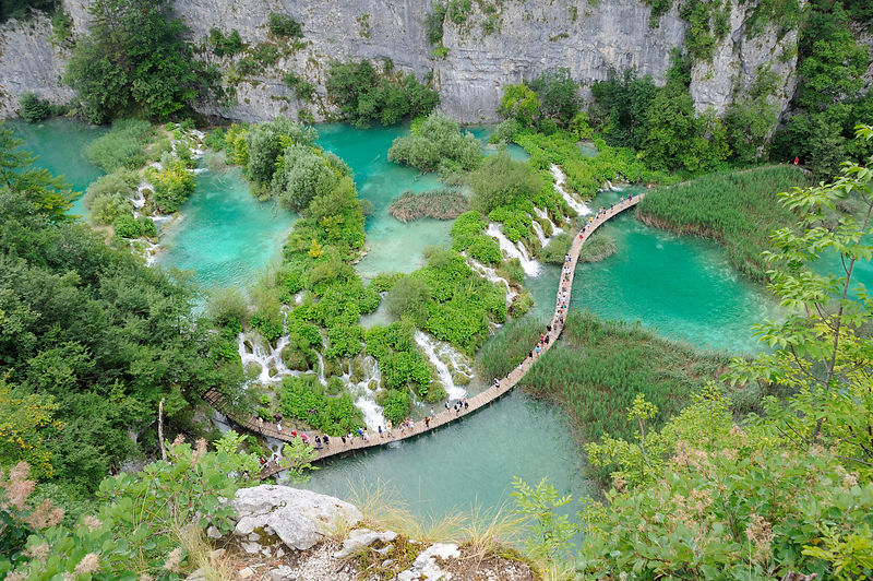 Overview of tourists on boardwalk below Velike kaskade waterfalls, Plitvice Lakes National Park, Croatia, July 2010.